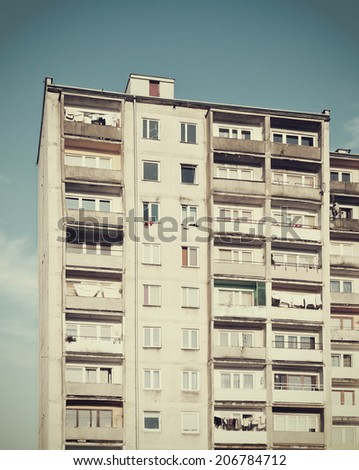 Old high apartment building built during communism. - stock photo