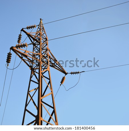 Old high voltage post on a background of blue sky with a place for text - stock photo