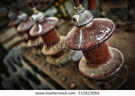old high-voltage power transformer insulation - stock photo
