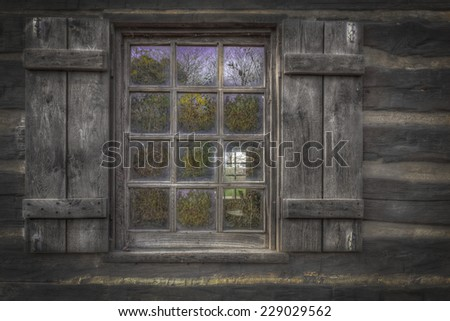 Old, histoprical window from old, wooden cabin house - stock photo