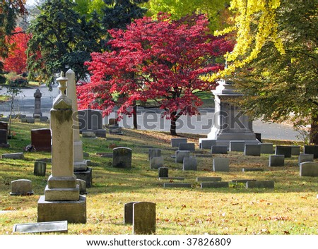 old historic cemetery with colorful autumn trees - stock photo