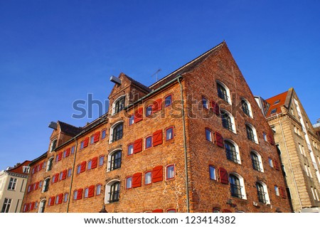 Old historic storehouse close to Nyhavn harbor on a sunny day - stock photo