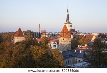 Old historic towers in warm sunset light. View over old town of Tallinn, Estonia, Europe.