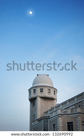 Old historical observatory with moon - stock photo