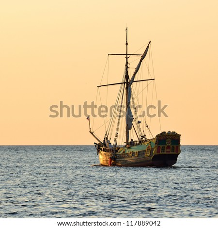 old historical sail ship at the sunset - stock photo