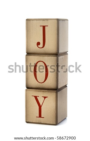 Old holiday blocks spelling the word Joy - stock photo