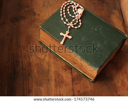 Old Holy Bibles and  Rosary Beads. - stock photo