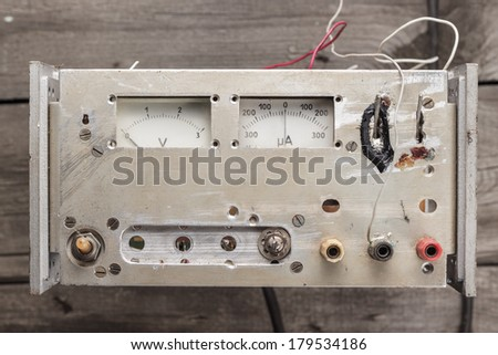 old homemade analogue voltmeter and amperemeter on the table - stock photo