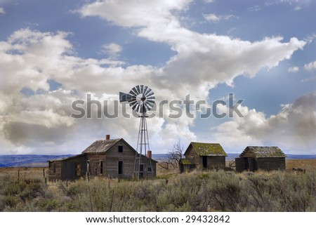 Old homestead with windmill near Kent, Oregon. - stock photo