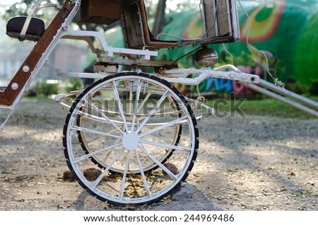 old horse drawn carriage on a cobblestone road