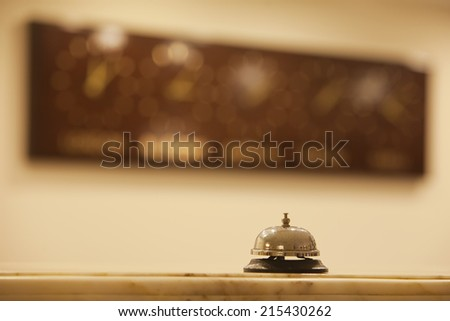 old hotel bell on a marble stand - stock photo