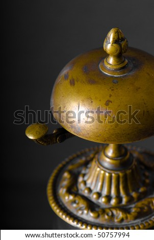 Old hotel bell on gray background - stock photo