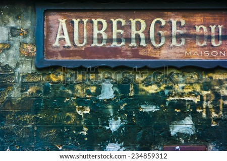 Old hotel signage in Paris, France. Auberge means hotel and maison means house. - stock photo