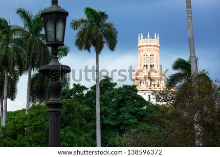 old hotel with palm trees in Havana - stock photo