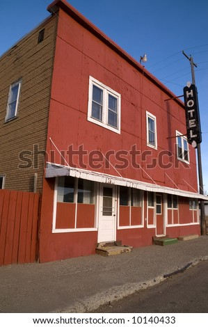 Old hotel with wood front and brick side in small town USA - stock photo