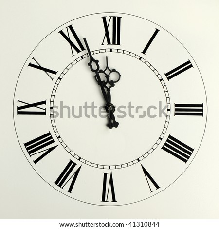 Old hours with figured arrows and the Roman figures eve 12 o'clock - stock photo
