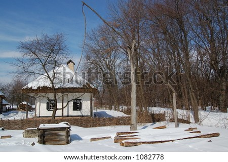 """Old house and draw-well in Kiev Museum """"Pirogovo"""" - stock photo"""