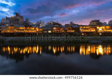 Old house and restaurant in Kamo river or kamogawa river at sunset, Gion, Kyoto, Japan
