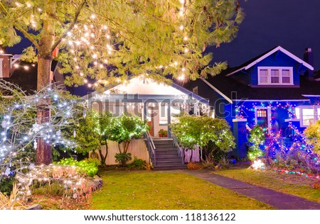 Old house decorated and lighted for Christmas and for New Year Eve at Night at Vancouver, Canada. - stock photo
