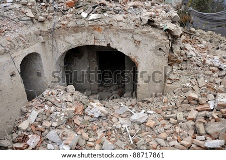 Old house demolition, cellar still stands - stock photo