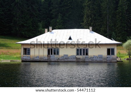 Old house in water,abandoned - stock photo