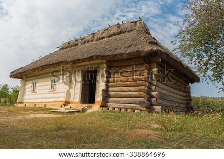 Old house of peasants in the museum Pirogovo. Ukraine - stock photo