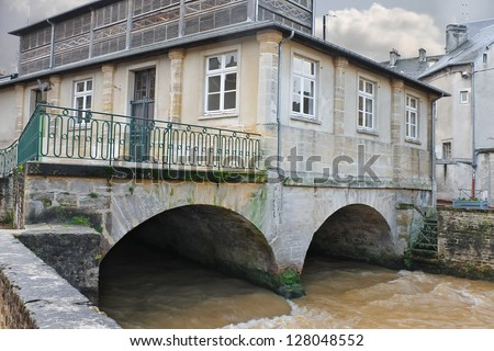 Old house on river in the town of Bayeux. Normandy, France - stock photo