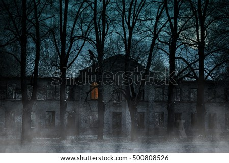 Old house with a Ghost in the moonlit night