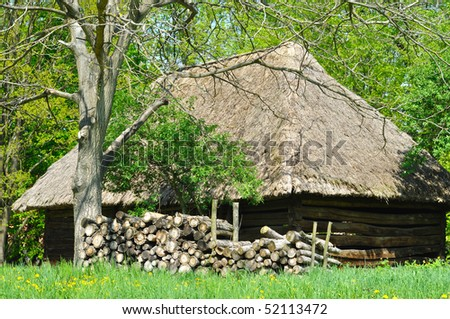 Old house with roof from straw in wood - stock photo
