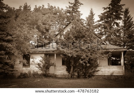 Old House With Veranda On Abandoned Farm In Manitoba Canada