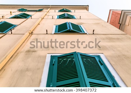 old house with windows shutters - classical facade background - stock photo