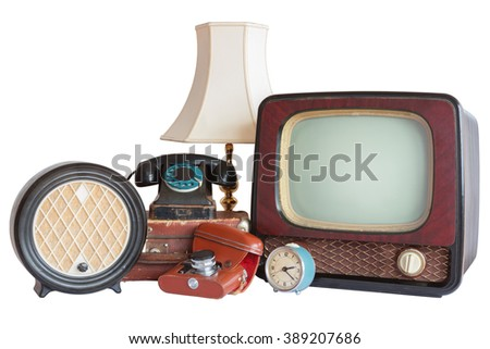 Old household items: TV, radio, camera, alarm, phone, table lamp, suitcase.   Old household items isolated on white background.  - stock photo
