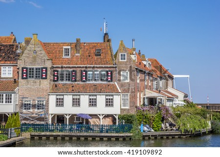 Old houses at the quay in Enkhuizen, The Netherlands - stock photo