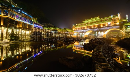 Old houses in Fenghuang county in Hunan, China. The ancient town of Fenghuang was added to the UNESCO World Heritage Tentative List in the Cultural category.  - stock photo