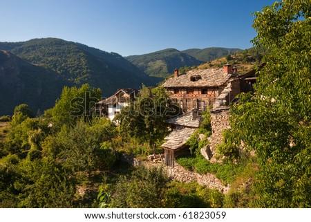 Old houses in historical Kovachevitsa village, Bulgaria. - stock photo