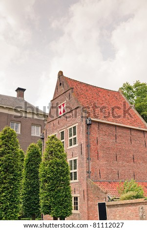 Old houses in old dutch village, Enkhuizen. - stock photo