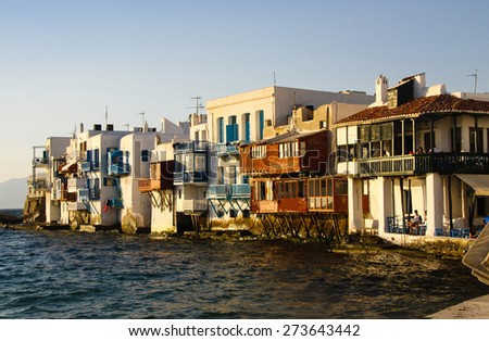 Old houses lit by the sunset sun in Mykonos. Greece - stock photo