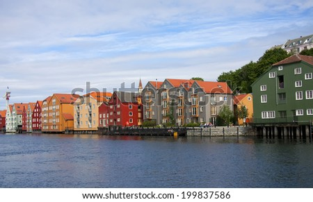 Old houses on a riverbank in Trondheim, Norway