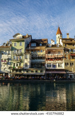 Old Houses on the Embankment Aare river in the Old Town of Thun in Switzerland. Canton of Bern.