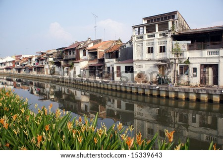 Old houses on the rivert in Melaka, Malaysia - stock photo