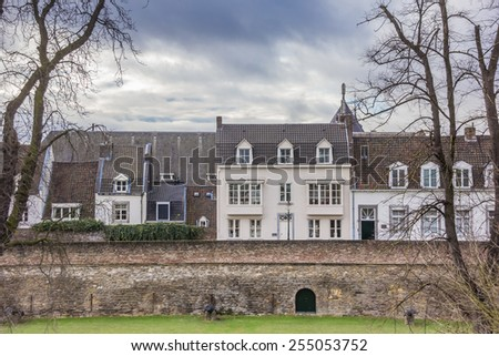 Old houses on the surrounding city wall in Maastricht, Netherlands - stock photo