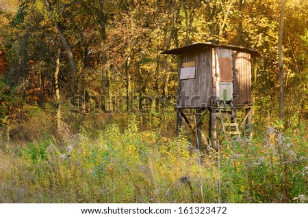 Old hunter's stand in the forest - stock photo