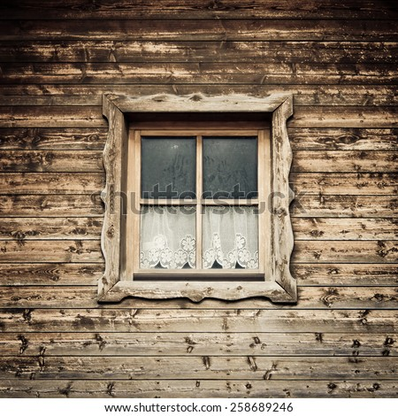 old hut and window with curtain  - stock photo