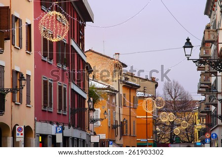 Old Imbriani street with houses painted in different colors used to be decorated for holidays in Parma, Italy. - stock photo