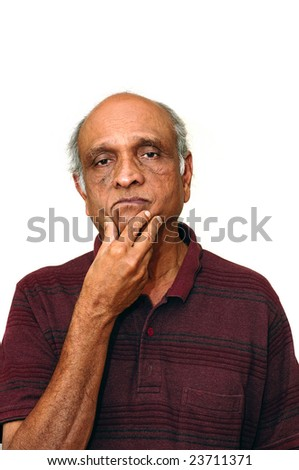 Old Indian Immigrant thinking about something - stock photo