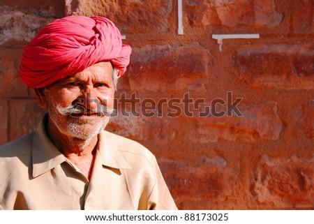 Old Indian man in turban - stock photo