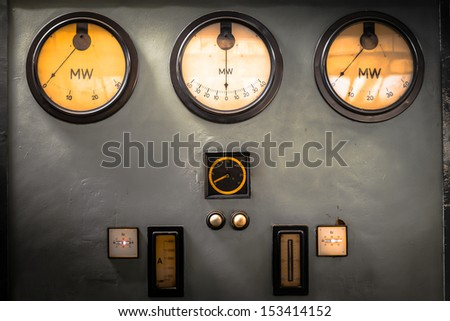old industrial electronics gauge instruments - stock photo