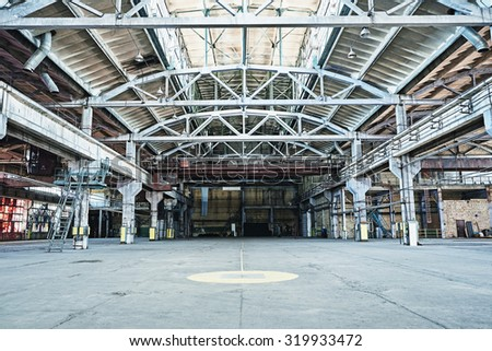 Old industrial grunge hall with metal structures - stock photo