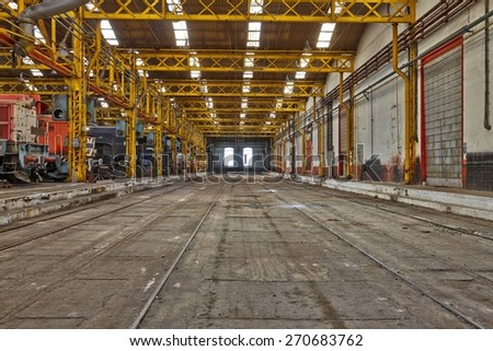 Old industrial interior hall with metal structures - stock photo