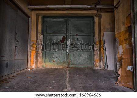 old industrial iron door, a machine factory - stock photo